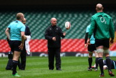 Ireland coach Declan Kidney watches his players warm up during training today ahead of tomorrows RBS Six Nations game against Wales at Millennium...