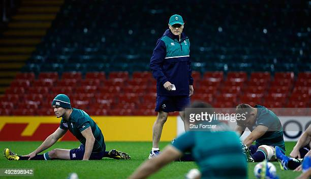 Ireland coach Joe Schmidt chats with fly half Jonathan Sexton looks on during Ireland training at the Millennium Stadium on October 16 2015 in...