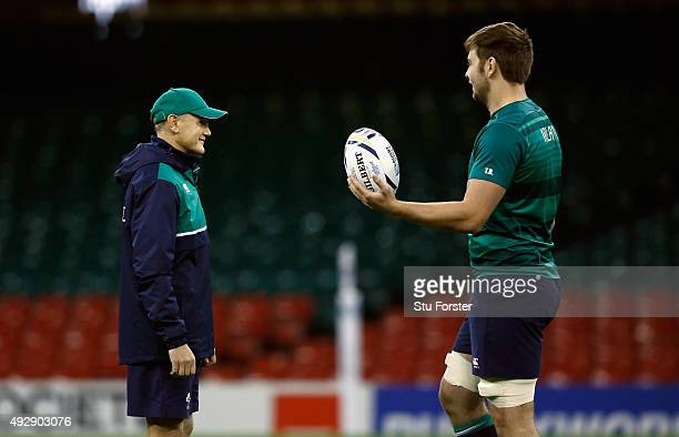 Ireland coach Joe Schmidt chats with player Iain Henderson during Ireland training at the Millennium Stadium on October 16 2015 in Cardiff Wales
