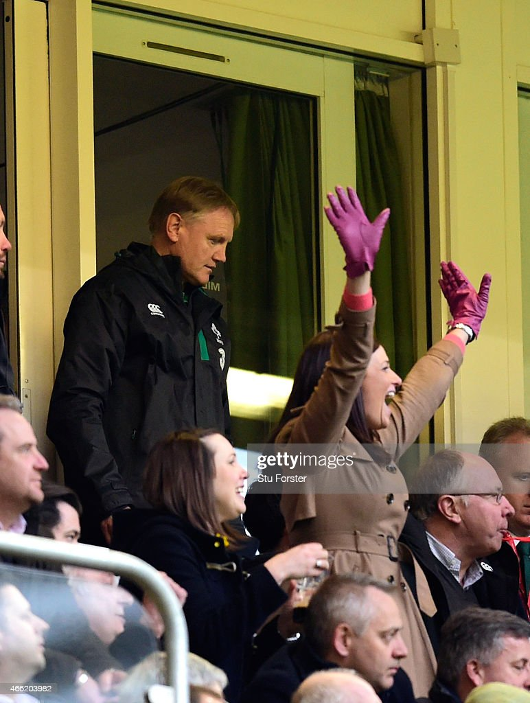 Ireland coach Joe Schmidt (l) looks on as Wales fans celebrate on the final whistle after the RBS Six Nations match between Wales and Ireland at Millennium Stadium on March 14, 2015 in Cardiff, Wales.