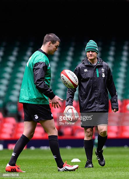 Ireland coach Joe Schmidt talks to fly half Johnny Sexton during training ahead of tomorrow's RBS Six Nations match against Wales at Millennium...