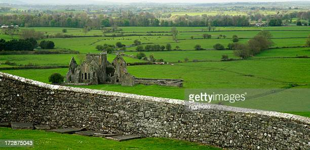 Ireland country scape with castle ruins and wall