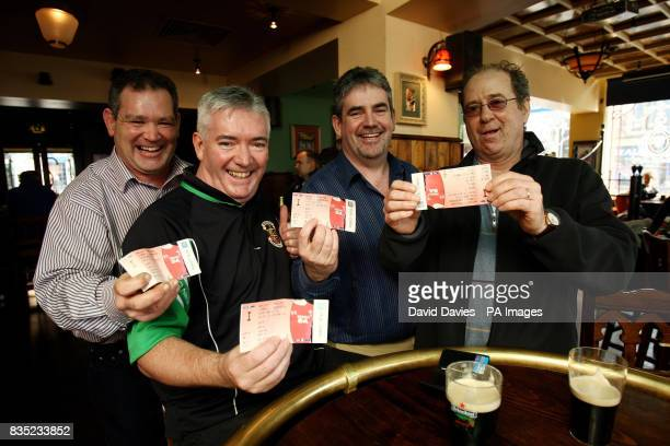 Ireland fans Sam Cawley Eamon Sweeney Dave Sweeney and Frank Mongey show off their match tickets in a bar in Cardiff in preparation for tomorrow's...