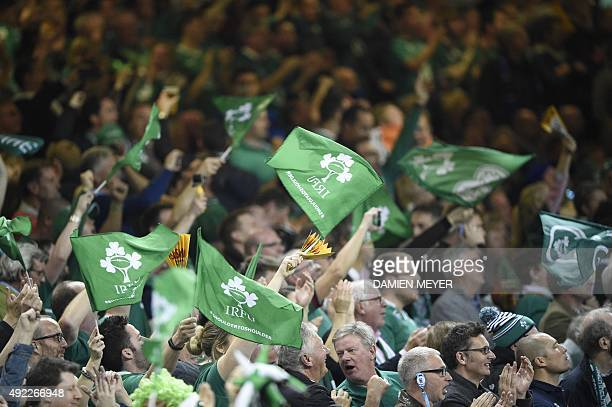 Ireland fans wave flags in the crowd during the Pool D match of the 2015 Rugby World Cup between France and Ireland at the Millennium Stadium in...