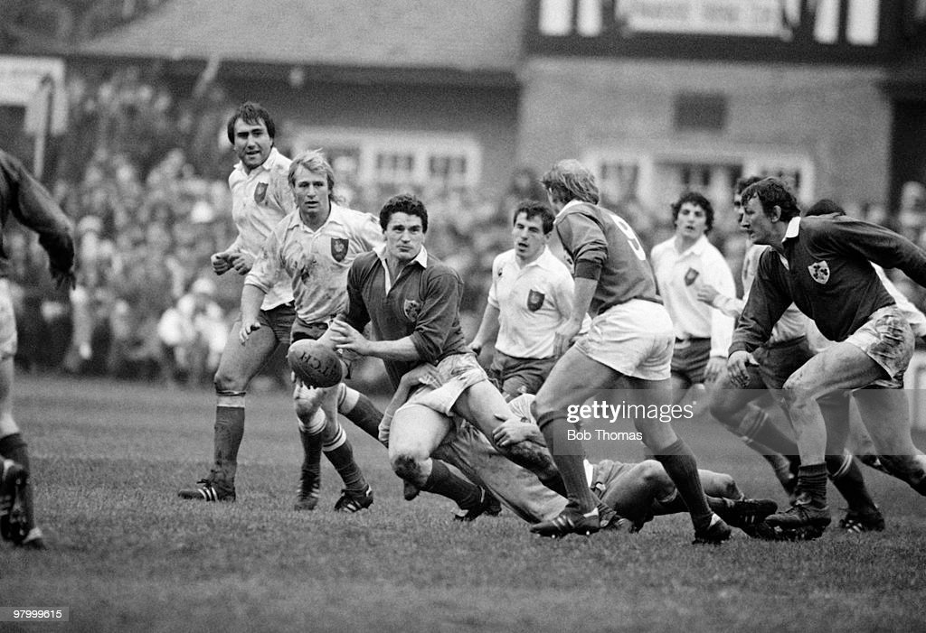 Ireland flanker John O'Driscoll prepares to pass the ball to Ireland scrum-half Robbie McGrath as France captain Jean Pierre Rives and Jean Luc Joinel look on during the Rugby Union International match held at Lansdowne Road, Dublin on 19th February 1983. Ireland beat France 22-16. (Bob Thomas/Getty Images).