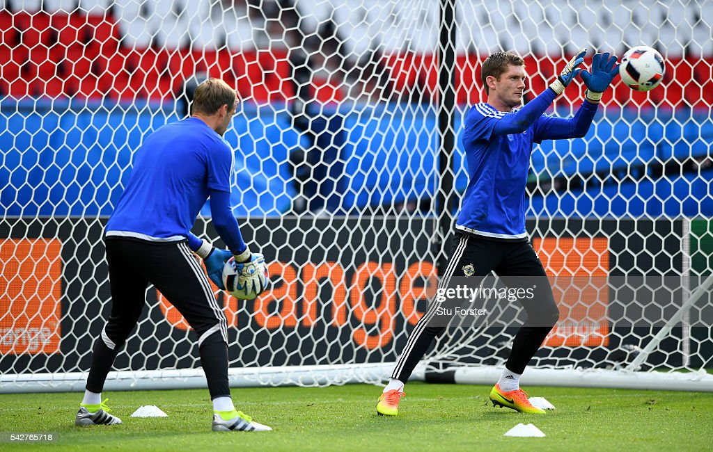 Ireland goalkeepers <a gi-track='captionPersonalityLinkClicked' href=/galleries/search?phrase=Michael+McGovern&family=editorial&specificpeople=2648917 ng-click='$event.stopPropagation()'>Michael McGovern</a> (r) and <a gi-track='captionPersonalityLinkClicked' href=/galleries/search?phrase=Roy+Carroll&family=editorial&specificpeople=206286 ng-click='$event.stopPropagation()'>Roy Carroll</a> in action during Northern Ireland training ahead of their Euro 2016 match against Wales at Parc des Princes on June 24, 2016 in Paris, France.
