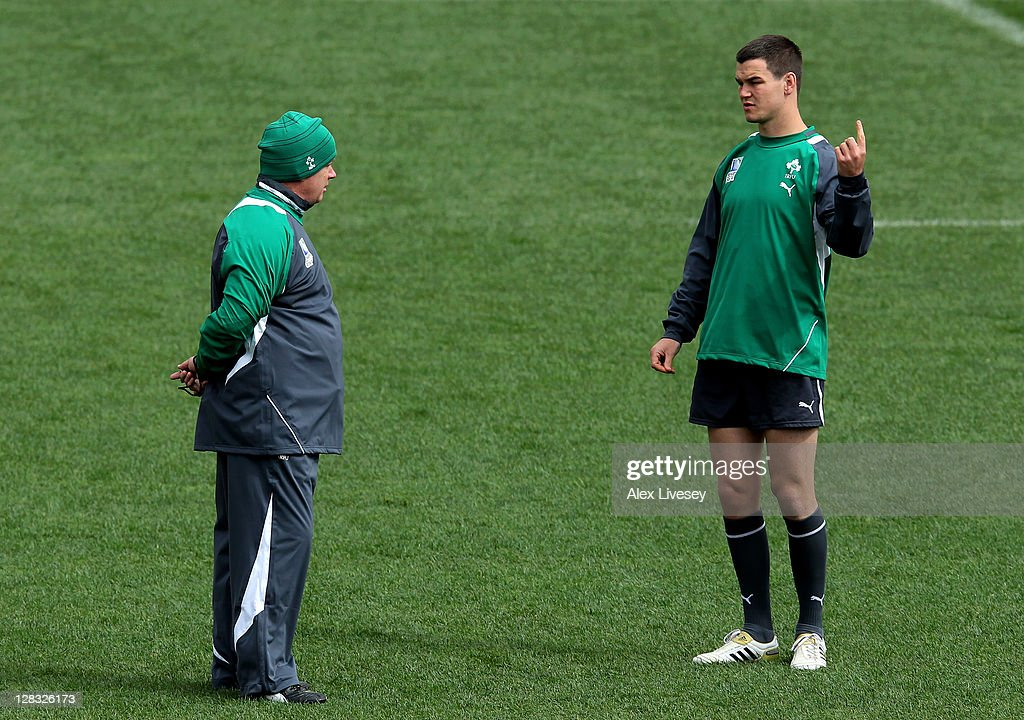 Ireland head coach Declan Kidney (L) speaks with flyhalf Jonathan Sexton during an Ireland IRB Rugby World Cup 2011 captain's run at Wellington Regional Stadium on October 7, 2011 in Wellington, New Zealand.