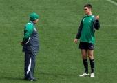 Ireland head coach Declan Kidney speaks with flyhalf Jonathan Sexton during an Ireland IRB Rugby World Cup 2011 captain's run at Wellington Regional...