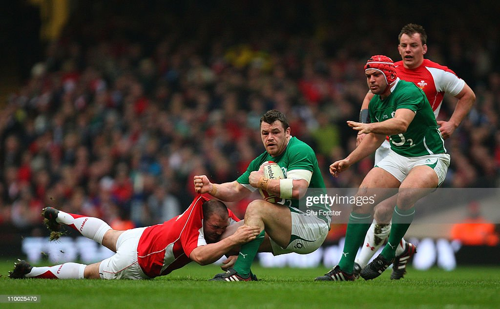 Ireland player Cian Healy brushes past Craig Mitchell of Wales during the RBS Six Nations Championship match between Wales and Ireland at the...