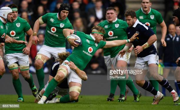 Ireland player Jamie Heaslip runs into the Scotland defence during the RBS Six Nations match between Scotland and Ireland at Murrayfield Stadium on...