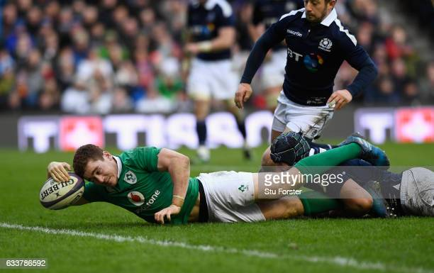 Ireland player Paddy Jackson dives over to score during the RBS Six Nations match between Scotland and Ireland at Murrayfield Stadium on February 4...