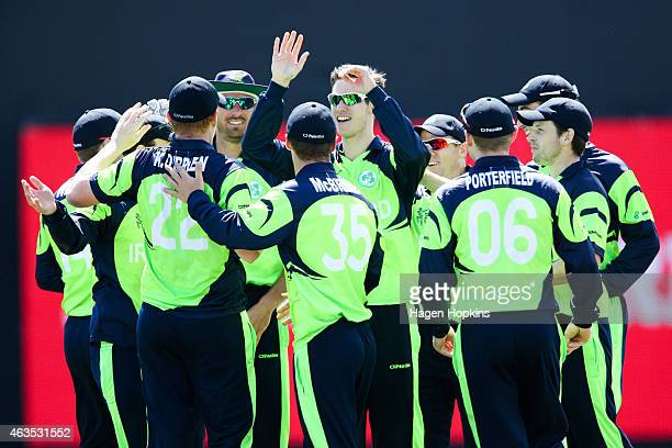 Ireland players celebrate the wicket of Chris Gayle of the West Indies during the 2015 ICC Cricket World Cup match between the West Indies and...