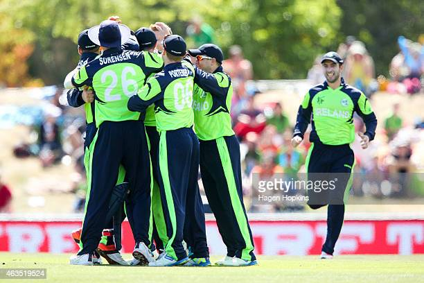 Ireland players celebrate the wicket of Darren Bravo of the West Indies during the 2015 ICC Cricket World Cup match between the West Indies and...