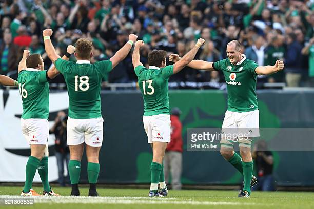 Ireland players celebrate their 4029 victory as the final whistle blows during the international match between Ireland and New Zealand at Soldier...