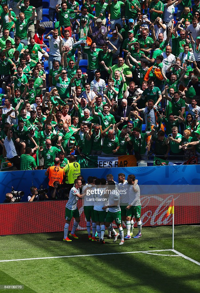 Ireland players celebrate their team's first goal in front of their supporters during the UEFA EURO 2016 round of 16 match between France and Republic of Ireland at Stade des Lumieres on June 26, 2016 in Lyon, France.