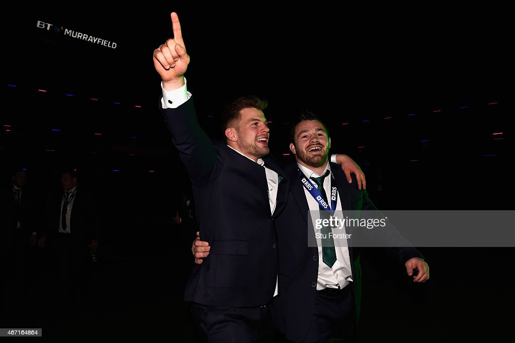 Ireland players Jordi Murphy and Cian Healy celebrate after the RBS Six Nations match between Scotland and Ireland at Murrayfield Stadium on March 21...