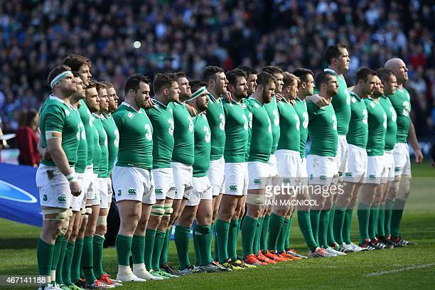 Ireland players line up for the anthems ahead of the Six Nations international rugby union match between Scotland and Ireland at Murrayfield in...
