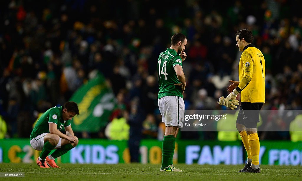 Ireland players Sean St Ledger (l) Marc Wilson (c) and goalkeeper David Forde (r) look on dejectedly after the FIFA 2014 World Cup Group C Qualifiying match between Republic of Ireland and Austria at Aviva Stadium on March 26, 2013 in Dublin, Ireland.