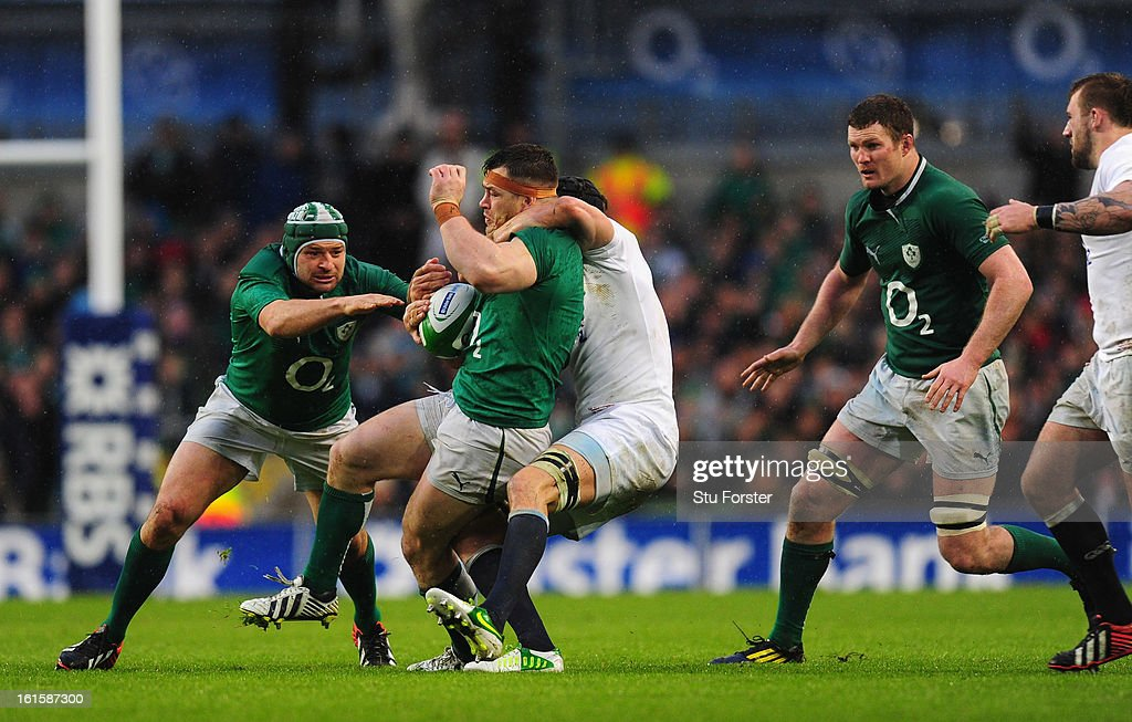 Ireland prop Cian Healy is tackled during the RBS Six Nations match between Ireland and England at Aviva Stadium on February 10, 2013 in Dublin, Ireland.