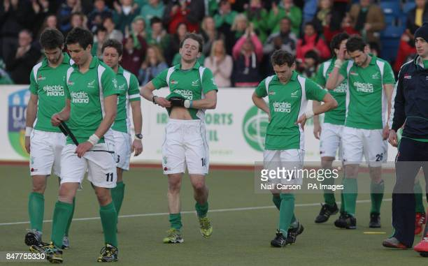 Ireland react after they were beaten during their International Hockey Federation Olympic qualifing match at Belfield in Dublin