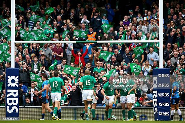 Ireland supporters celebrate as Sean Cronin of Ireland scores his team's seventh try during the RBS Six Nations match between Ireland and Italy at...