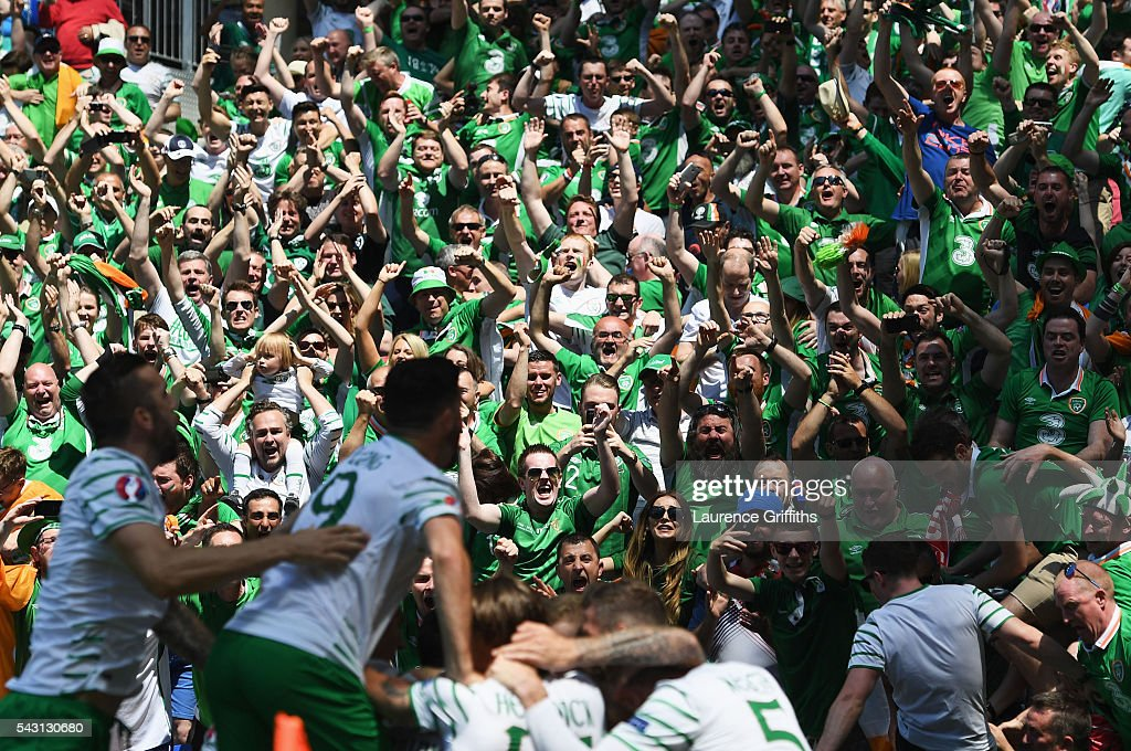 Ireland supporters celebrate their team's first goal during the UEFA EURO 2016 round of 16 match between France and Republic of Ireland at Stade des Lumieres on June 26, 2016 in Lyon, France.
