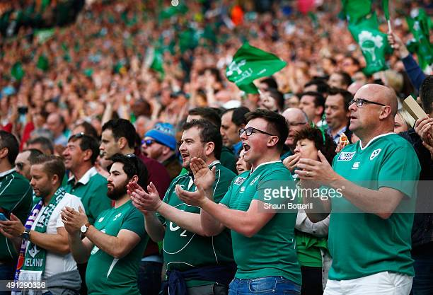 Ireland supporters cheer prior to the 2015 Rugby World Cup Pool D match between Ireland and Italy at the Olympic Stadium on October 4 2015 in London...