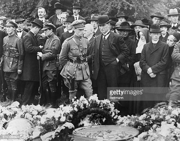 The Funeral Of Michael Collins Capt O'Reilly with Sean Collins Miss Collins and Sister Celestine beside grave of Michael Collins immediately after...