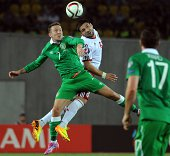 Ireland's Aiden McGeady heads the ball with Georgia's Murtaz Daushvili during the UEFA Euro 2016 group D qualifying football match in Tbilisi on...