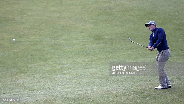 Ireland's amateur golfer Paul Dunne chips onto the 18th green during his second round on day two of the 2015 British Open Golf Championship on The...