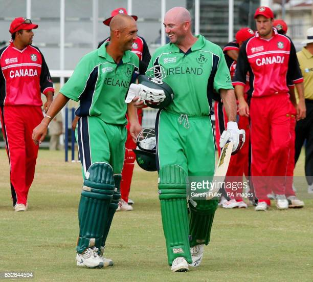 Ireland's Andre Botha and Jeremy Bray leave the field following their voctory over Canada in their Warmup match at St Augustine Trinidad