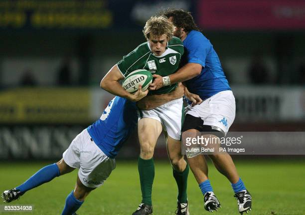 Ireland's Andrew Trimble is tacked by Italy's Alessandro Troncon and Martin Castrogiovanni during the International match at Ravenhill Belfast