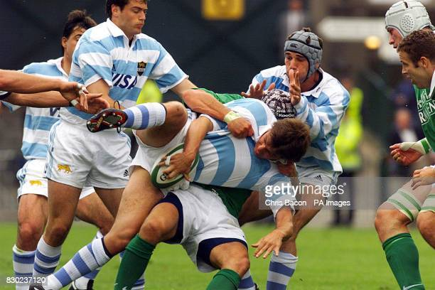 Ireland's Andrew Ward brings down Gonzzalo Quesada of Argentina during a friendly match at Lansdowne Road Dublin