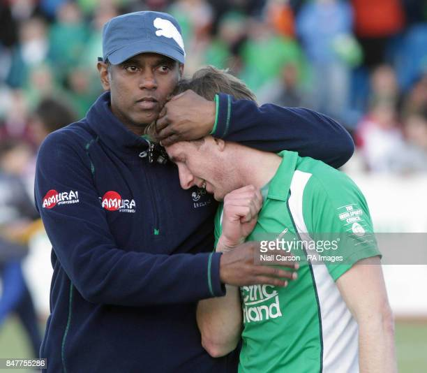Ireland's Arul Anthoni and Andrew McConnell react after they were beaten during their International Hockey Federation Olympic qualifing match at...