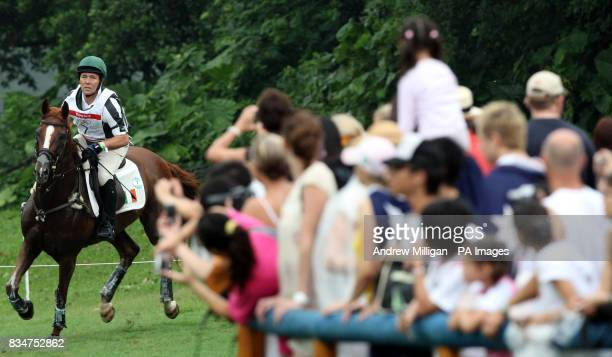 Irelands Austin O'Connor on Hobby Du Mee at the water jump at fence 5/6 takes part in the cross country section of the Three Day Eventing held at the...