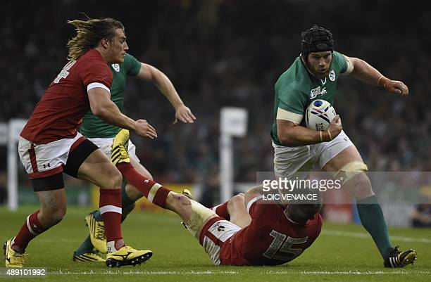 Ireland's back row Sean O'Brien is tackles by Canada's fullback Matt Evans during a Pool D match of the 2015 Rugby World Cup between Ireland and...