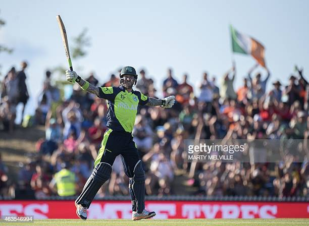 Ireland's batsman John Mooney celebrates their win in the Pool B 2015 Cricket World Cup match between Ireland and the West Indies at Saxton Park Oval...