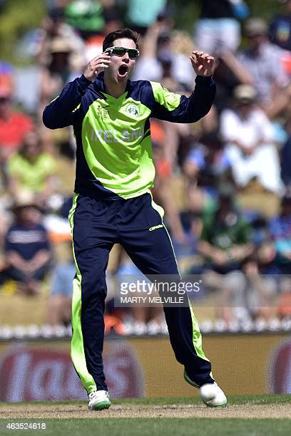 Ireland's bowler George Dockrell reacts to a missed catch during the Pool B 2015 Cricket World Cup match between Ireland and the West Indies at...