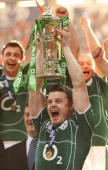 Ireland's captain Brian O'Driscoll holds the Six Nations trophy after the Six Nations title deciding rugby match at the Millennium Stadium in Cardiff...