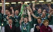 Ireland's captain Brian O'Driscoll raises the Six Nations trophy after the Six Nations title deciding rugby match at the Millennium Stadium in...