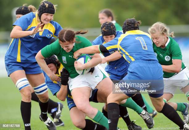 Ireland's captain Fiona Coghlan is tackled during the Women's World Cup at Surrey Sports Park Guilford