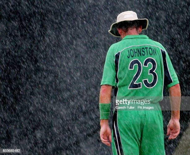 Ireland's captain Trent Johnston walks off the field as rain interupts play during the ICC Cricket World Cup Super Eight match against New Zealand at...