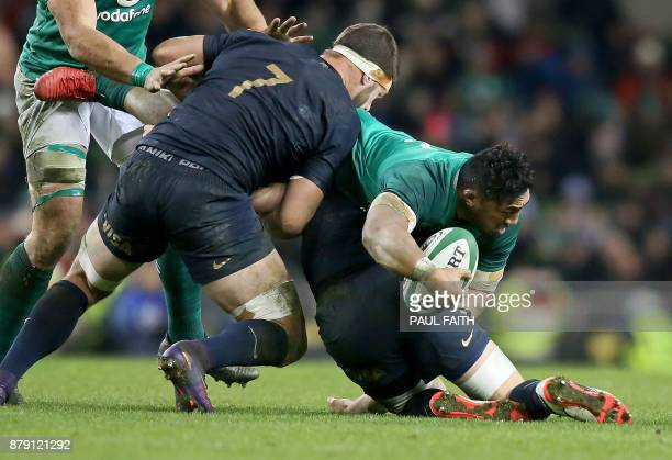 Ireland's centre Bundee Aki is tackled by Argentina's flanker Marcos Kremer during the autumn international rugby union test match between Ireland...