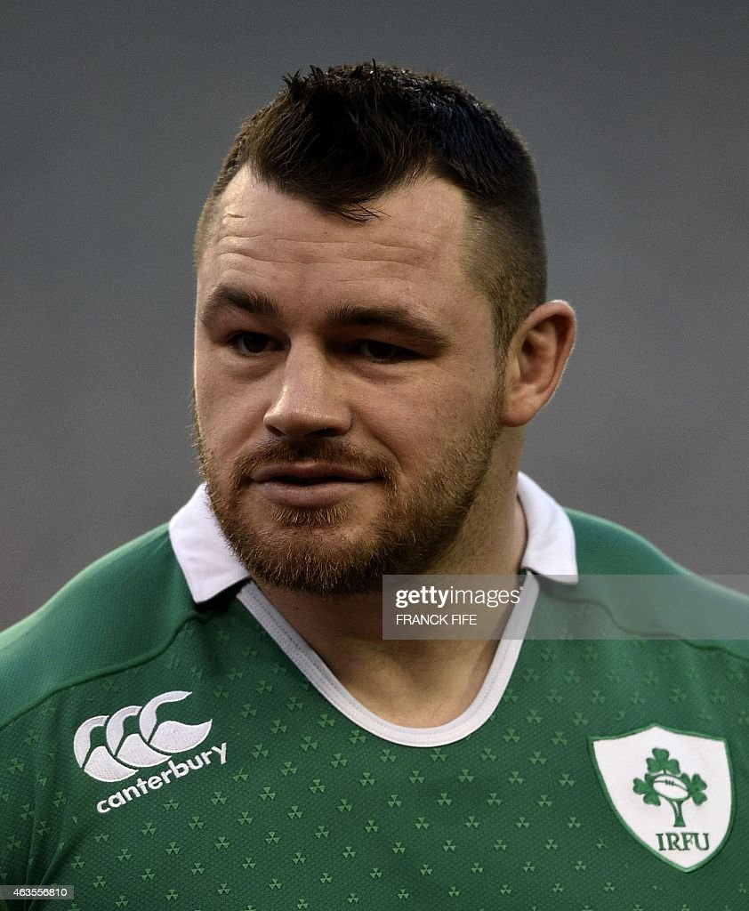 Ireland's Cian Healy listens to the national anthems prior to the Six Nations international rugby union match between Ireland and France in Dublin on...