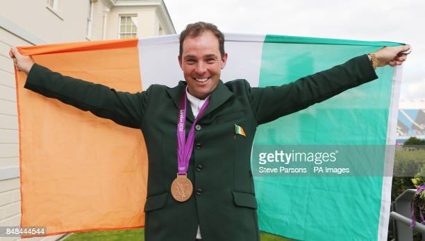 Ireland's Cian O'Connor celebrates with his bronze medal after the Individual Jumping Final B at Greenwich Park on the twelfth day of the London 2012...