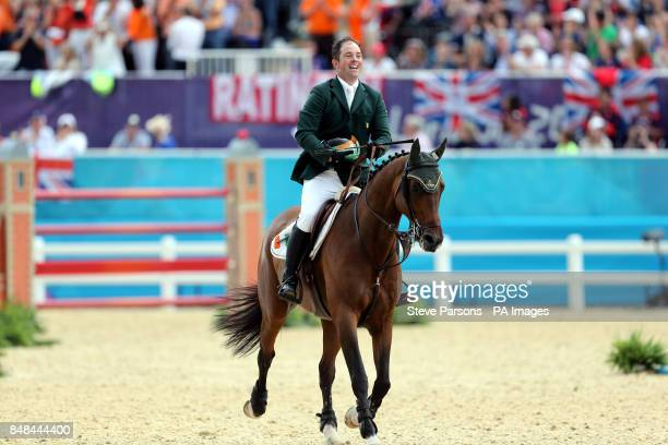Ireland's Cian O'Connor on Blue Loyd 12 celebrates his bronze medal after the Individual Jumping Final B at Greenwich Park on the twelfth day of the...