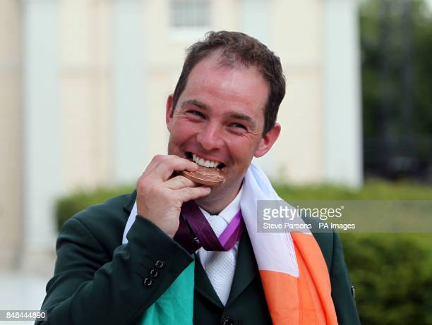 Ireland's Cian O'Connor with his bronze medal in the Equestrian Jumping Individual Final Round B at Greenwich Park on the twelfth day of the London...