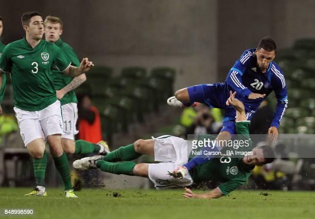 Ireland's Ciaran Clare and Greece's Jose Holebas battle for the ball during the International Friendly at the Aviva Stadium Dublin Ireland