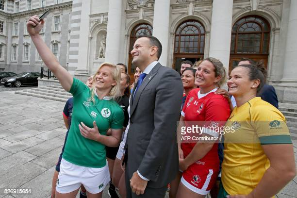 Ireland's Claire Molloy takes a selfie photograph with Ireland's Prime Minister Leo Varadkar and the captain's of the teams competing in the...