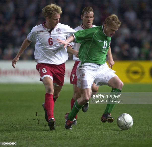 Ireland's Damien Duff holds off Denmark's Christian Poulsen and Brian Sten Nielsen during their International Friendly match at Lansdowne Road Dublin